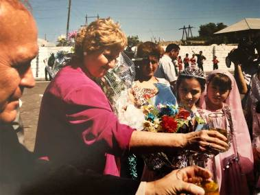 Jo Ann accepting flower from locals