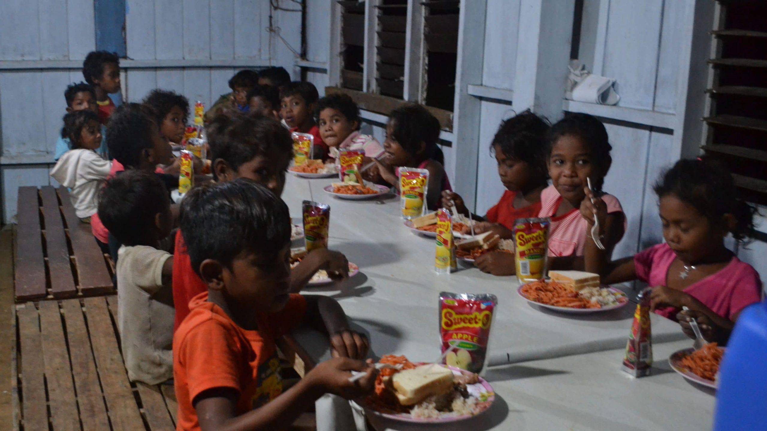 Kids eating Christmas dinner