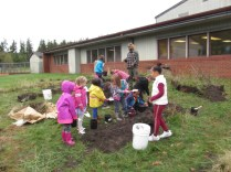 Children came and helped spread out the soil