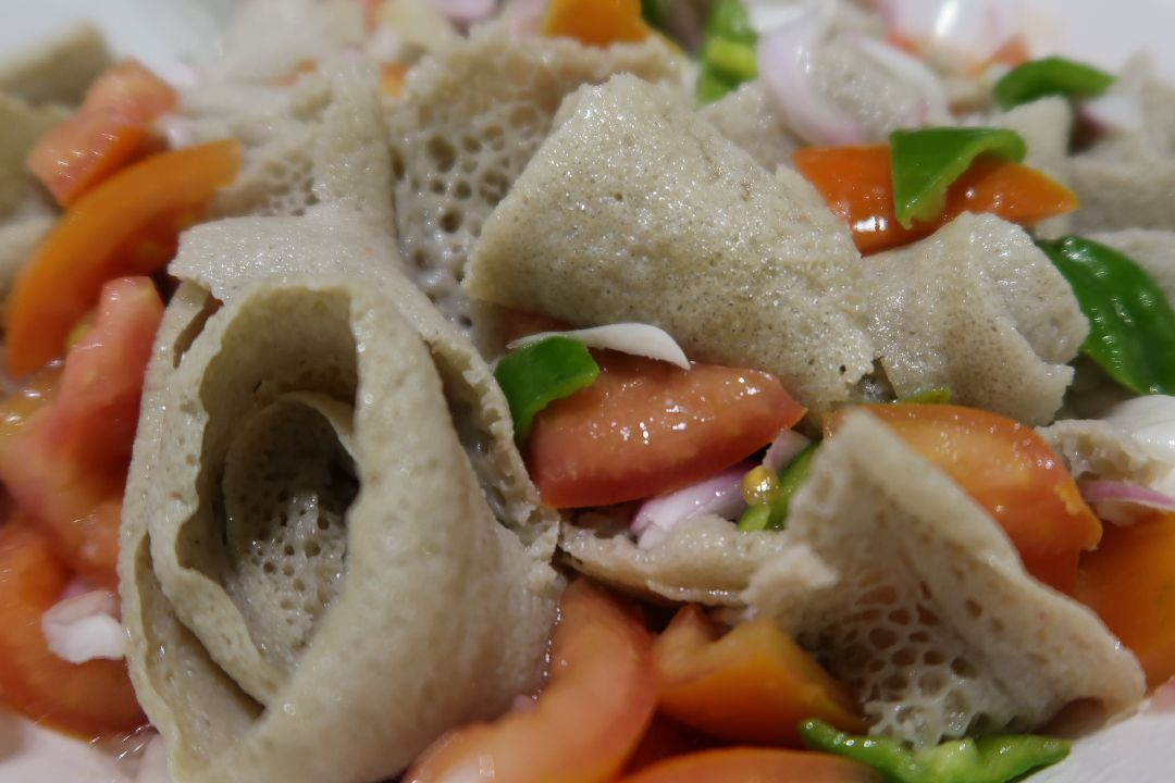 injera salad.whileinafrica