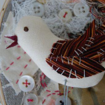 fabric collage with handmade bird