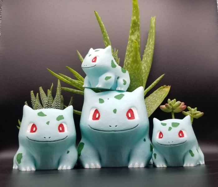 Pokemon vases of various sizes with cacti