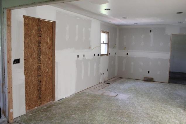 Sliding door removed with drywall taped and mudded