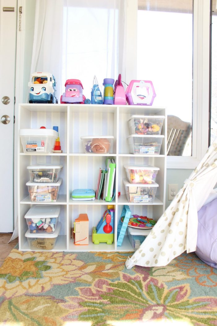 Inexpensive toy organization and a simplified playroom: Click here to read about the steps and very minimal things needed to declutter and organize the toys in your house once and for all. Whether you have a playroom or not, these tips for quick organization will not only help you feel like you have some control over the clutter, but your kids will also play better with what they have (hint: it's because they'll have less!). Click here to read more. | Whimsical September