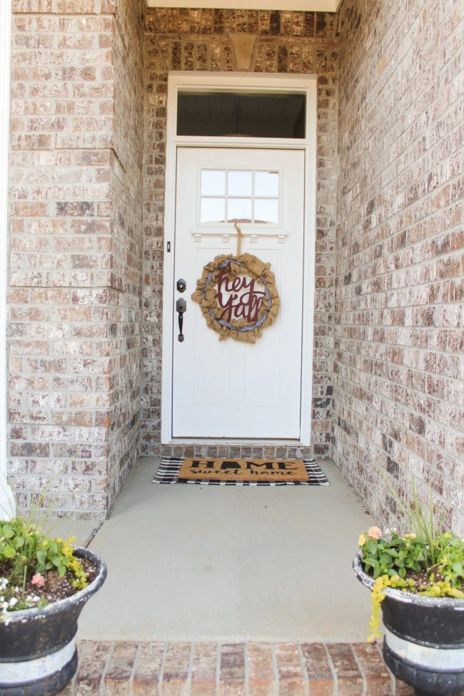 Styling our front porch: We knew we wanted our front porch to be bright and inviting, so we chose a color scheme and got to work! This combination of trendy + timeless styles makes this porch a Southern Living dream! Click here to read more.