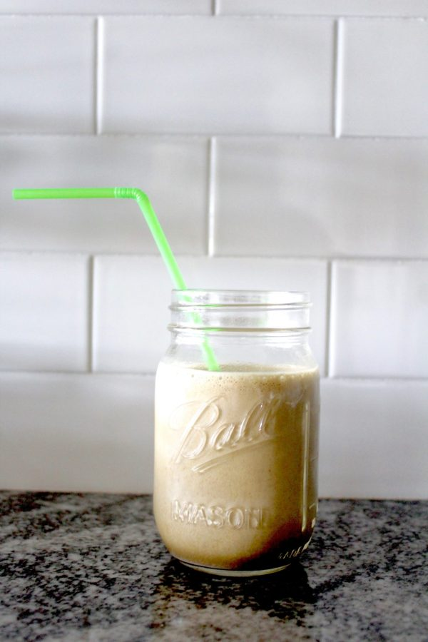 This caffeinated chocolate protein breakfast smoothie recipe combines all good things. Unsweetened vanilla almond milk tastes different than cows milk, but mixed into a smoothie like this, and there is no difference. The frozen banana thickens the smoothie just a hair. A couple shakes of cinnamon takes the bite out of the black coffee, and the chocolate protein powder gives it the rich, indulgent taste that makes it taste more like a treat than breakfast. Finally, the cup of spinach is effortless because you won't even taste it, and just like that, you'll knock out a major (!) portion of your recommended veggies per day.