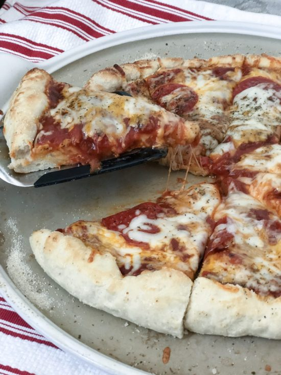 This easy homemade pizza dough recipe can be made a couple hours or a couple weeks before mealtime. It's simple, fast, freezable, and most importantly a recipe your whole family will love. This recipe has been revised and perfected for years, and now it's a crowd-pleaser that has everyone asking for seconds (or thirds). The dough is slightly sweet while providing a nice base for an endless variety of toppings. Enjoy!