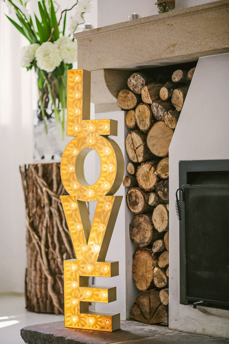LOVE Light Letters Fireplace Rustic Laid Back Tipi Wedding http://helenrussellphotography.co.uk/