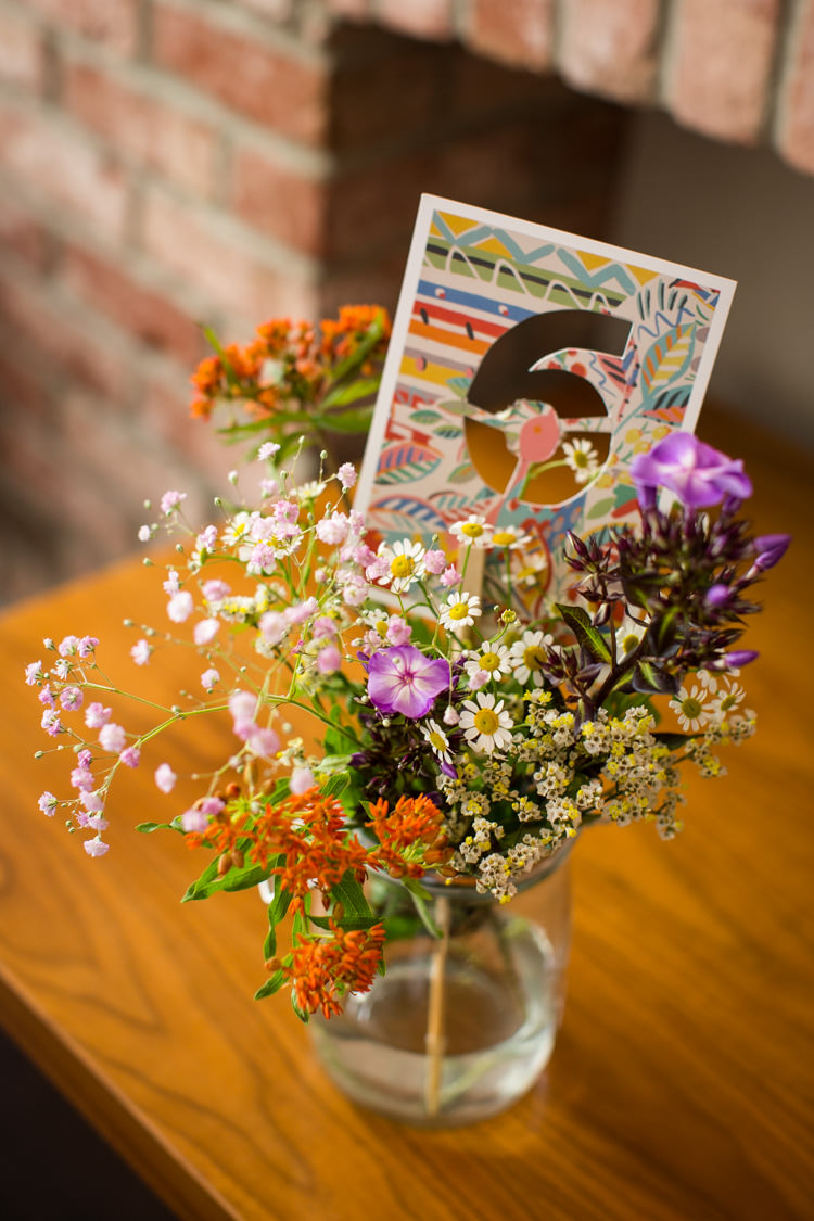 Jar Flowers Wild Blooms Table Numbers Colourful DIY Village Hall Wedding http://samanthagilrainephotography.com/