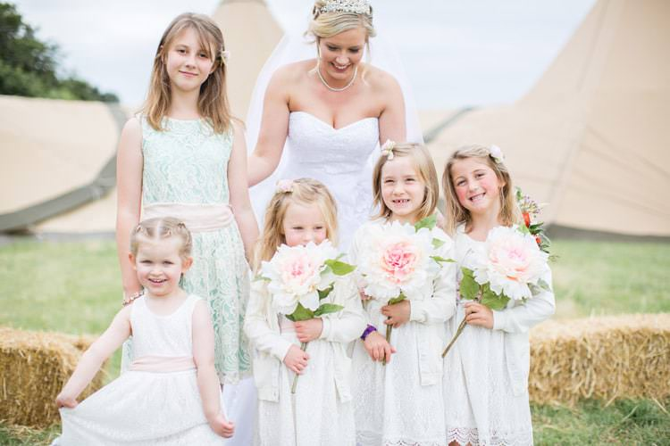 Flower Girls White Dresses Giant Paper Flowers Family Farm Festival Wedding https://amylouphotography.co.uk/