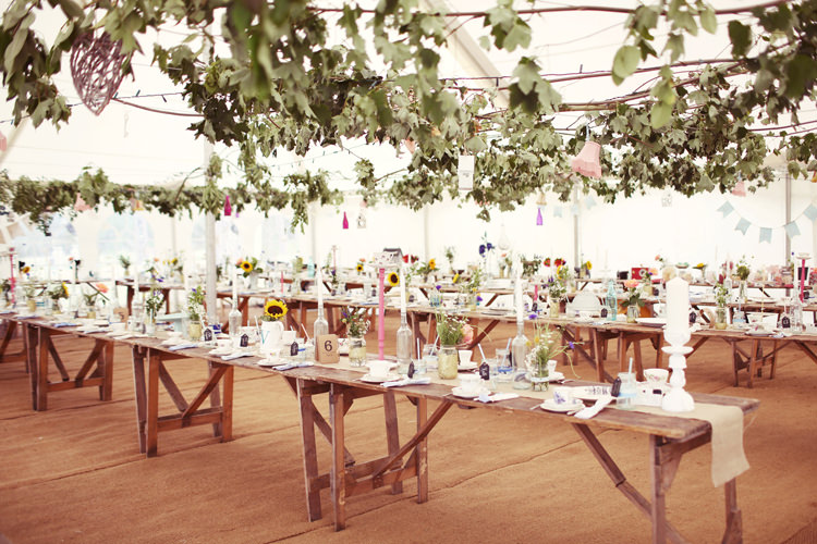 MArquee Long Tables Foliage Hanging Mismatched Fairground Woodland Wedding http://www.rebeccaweddingphotography.co.uk/