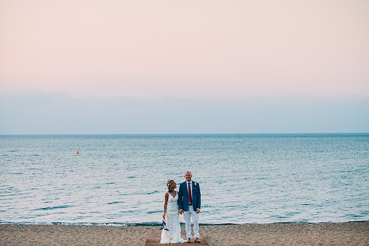 Bride Stella York Lace Gown Groom Royal Blue Coat Red Tie Ocean Sunset Beautiful Traditional Greek Destination Wedding in Cyprus http://www.jonnybarratt.com/