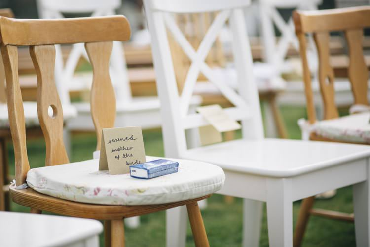 Mismatched Chairs Ceremony Wild Flowers Outdoors Heartfelt DIY Wedding http://www.mattandesther.co.uk/