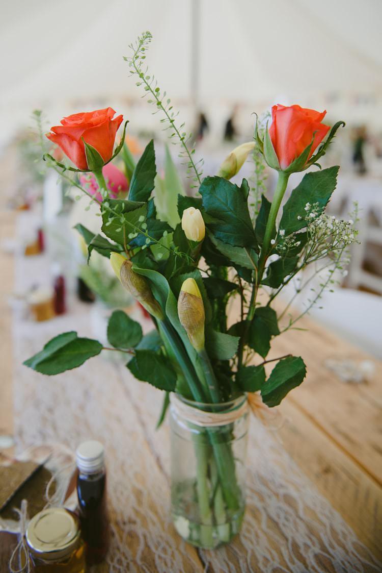 Colourful Jar Flowers Rose Jar Centrepiece Indie Rustic Beach Marquee Wedding http://www.abiriley.co.uk/