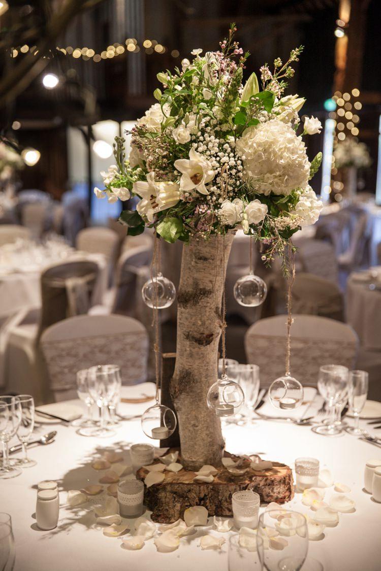 Tree Flower Log Centrepiece Decor Tables Cosy Winter Barn Wedding http://kerryannduffy.com/