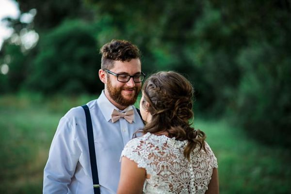 First Look Groom Light Blue Shirt Cream Bow Tie Navy Suspenders Bride Lace Bridal Gown With Buttons Soft Curls Hairstyle Trees Grass Ethereal Boho Wedding Ideas http://perfectcapturephoto.com/