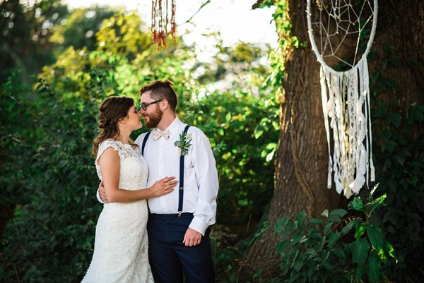 Bride Lace Bridal Gown With Buttons Groom Navy Pants Suspenders Cream Bow Tie Greenery Buttonhole Hanging Dreamcatchers Trees Ethereal Boho Wedding Ideas http://perfectcapturephoto.com/