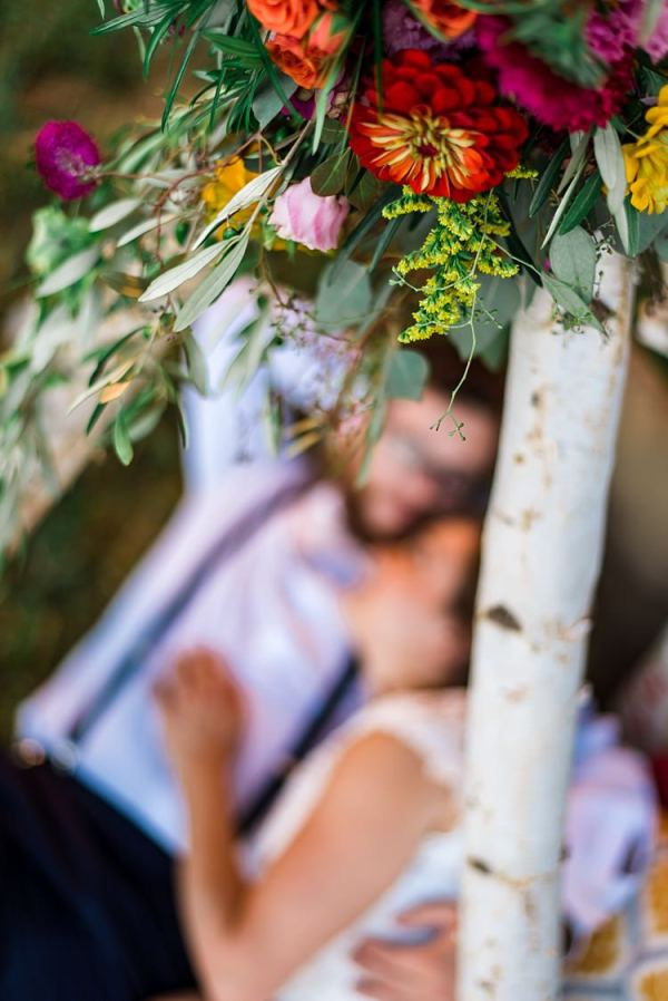 Teepee Multicoloured Florals Pink Red Yellow Orange Bride Groom Ethereal Boho Wedding Ideas http://perfectcapturephoto.com/