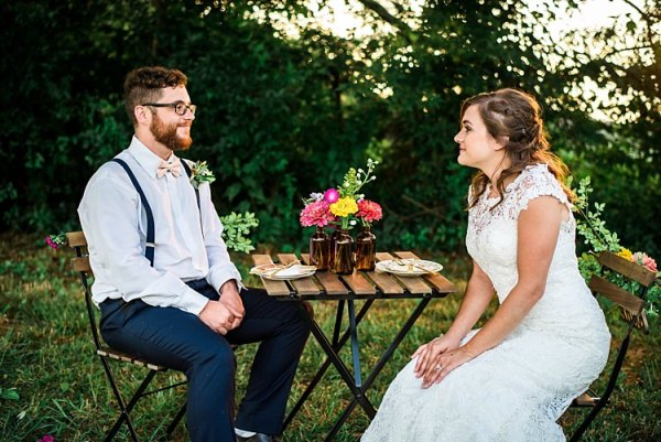 Bride Lace Bridal Gown With Buttons Groom Navy Pants Suspenders Cream Bow Tie Greenery Buttonhole Table Multicoloured Florals Brown Glass Vases Trees Grass Ethereal Boho Wedding Ideas http://perfectcapturephoto.com/