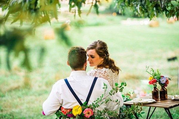 Bride Lace Bridal Gown With Buttons Groom Navy Suspenders Wooden Table Colourful Flowers Brown Glass Vases Chair Multicoloured Floral Decoration Trees Grass Ethereal Boho Wedding Ideas http://perfectcapturephoto.com/
