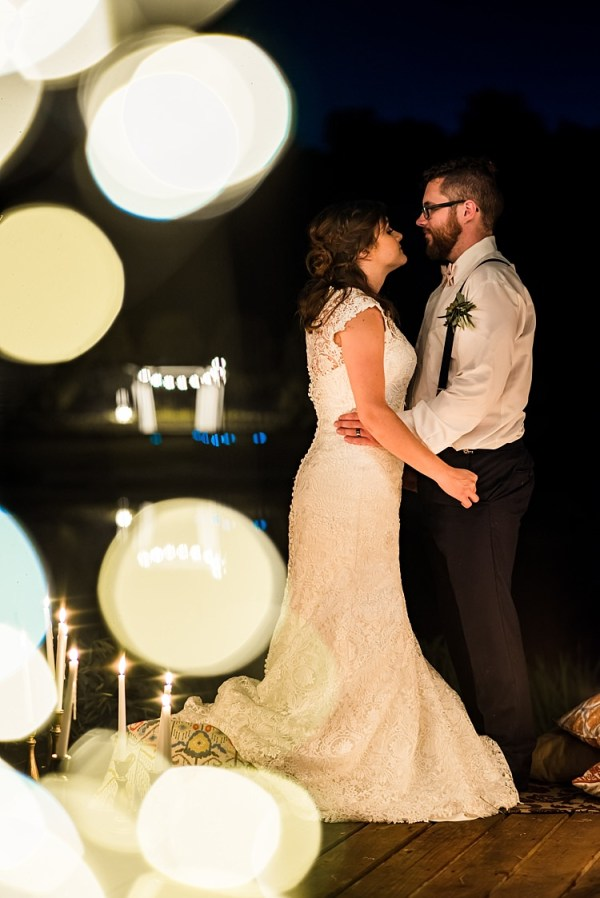 Bride Lace Bridal Gown With Buttons Groom Navy Pants Suspenders Cream Bow Tie Buttonhole Fairy Lights Candle Sticks Patterned Cushions Ethereal Boho Wedding Ideas http://perfectcapturephoto.com/