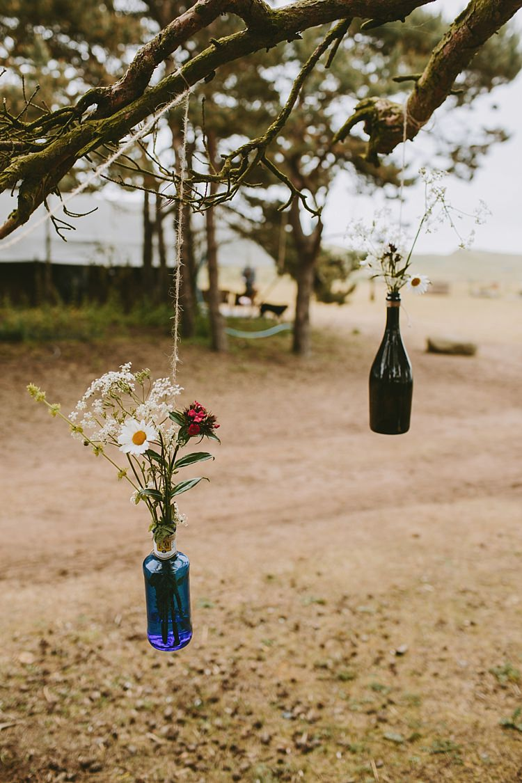 Hanging Bottle Flowers Beautiful Bohemian Beach Glamping Wedding http://www.thecurries.co/