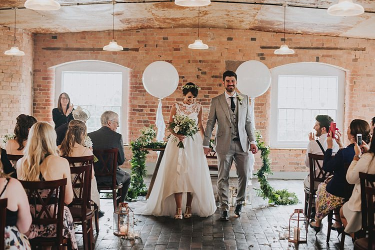 Giant Balloons Ceremony Aisle Backdrop Industrial Cool Mill Greenery Wedding http://www.beckyryanphotography.co.uk/