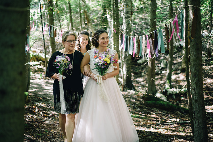 Outdoor Ceremony Bride Allure Champagne Lace Tulle Bridal Gown Multicoloured Floral Bouquet Mother Entrance Hanging Décor Coloured Ribbons Trees Woodland Waterfall Mint Wedding Ontario http://www.laurenmccormickphotography.com/