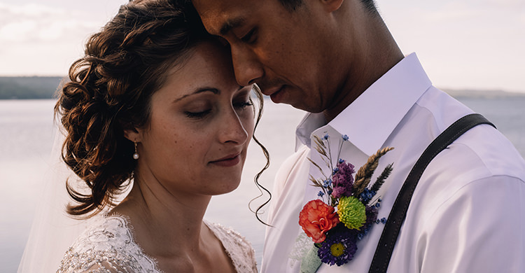 Bride Allure Champagne Lace Tulle Bridal Gown Pearl Earrings Groom White Shirt Brown Leather Suspenders Navy Pants Multicoloured Floral Buttonhole Woodland Waterfall Mint Wedding Ontario http://www.laurenmccormickphotography.com/