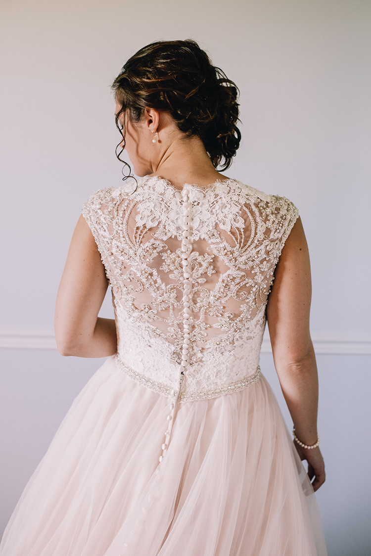 Bride Allure Champagne Lace Tulle Bridal Gown Buttons Pearl Earrings Soft Curls Hairstyle Woodland Waterfall Mint Wedding Ontario http://www.laurenmccormickphotography.com/