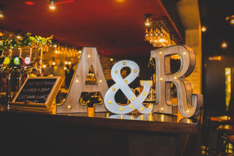 Letter Lights Autumn Garden Books Wedding http://www.emmahillierphotography.com/