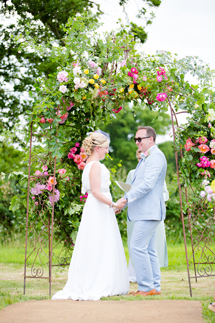 Flower Arch Floral Outdoor Ceremony UK Colourful Pastel Home Made Farm Wedding http://helencawtephotography.com/