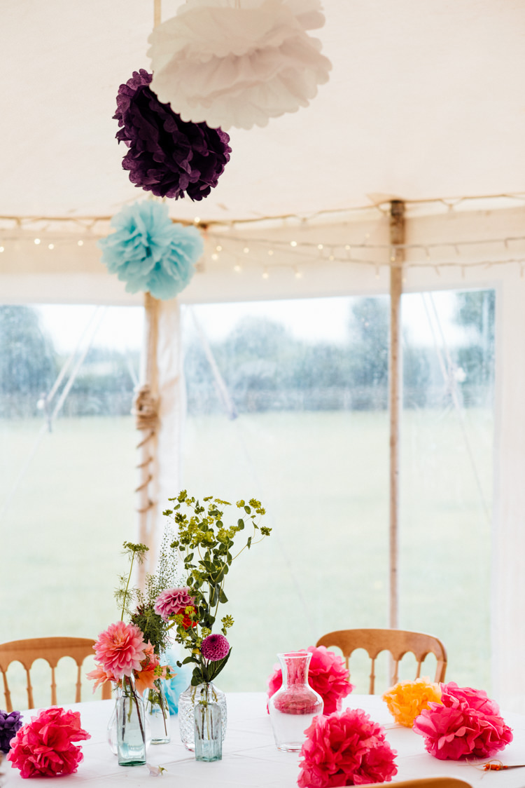 Marquee Pom Poms Dahlia Flowers Bottles Centrepiece Decor Multicoloured Home Made Glamping Wedding http://www.michellewoodphotographer.com/