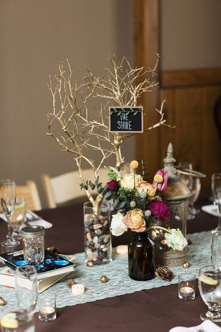 Reception Table Setting Book Lover Theme Painted Branch Blackboard Sign Place Name Glass Vase Stones Dark Bottle Multicoloured Florals Books Candles Whimsical Forest Harry Potter Wedding http://heatherelizabethphotography.com/