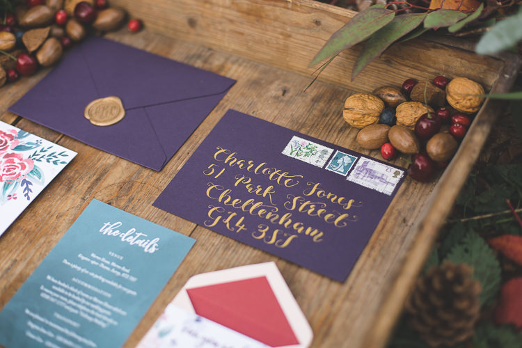 Stationery Floral Purple Red Gold Envelope Calligraphy Magical Autumn Outdoorsy Woodland Wedding Ideas http://kirstymackenziephotography.co.uk/