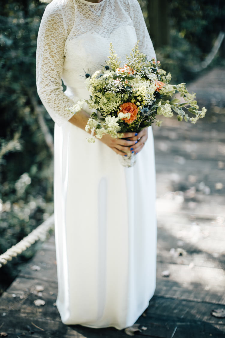 Bride Handmade Lace Floral Belt Bridal Gown Bouquet Orange Carnations Thistle Gypsophila Lace Ribbon Adventure Inspired Woodland Wedding North Carolina http://www.amandasuttonphotography.com/