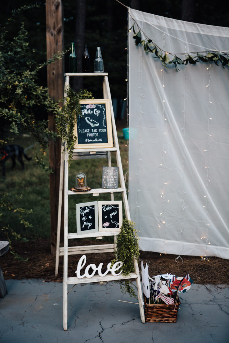 Reception DIY Photo Booth Ladder Blackboard Sign Props Fairy Lights Adventure Inspired Woodland Wedding North Carolina http://www.amandasuttonphotography.com/