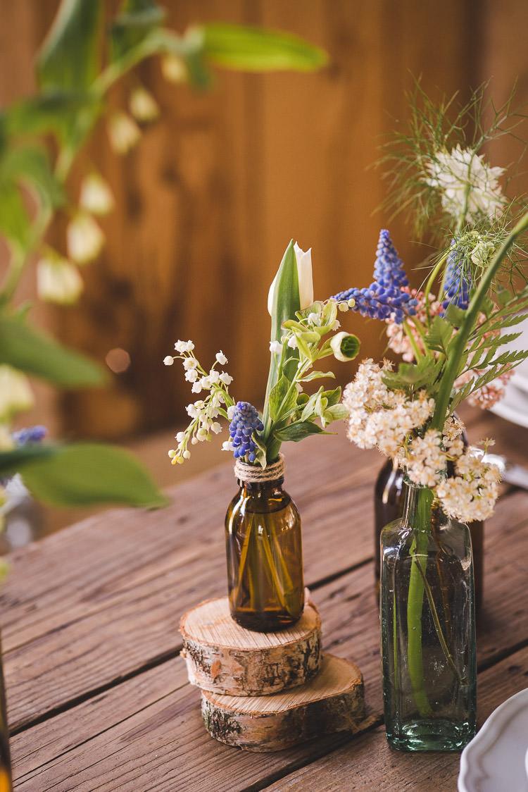 Brown Bottle Flowers Log Magical Spring Bluebell Woodland Wedding Ideas http://helinebekker.co.uk/