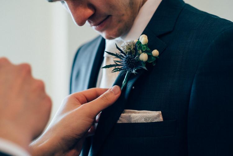 Groom DKNY Suit Moss Bros Buttonhole Thistle Heartwarming Festive Winter Wedding http://www.nikkivandermolen.com/