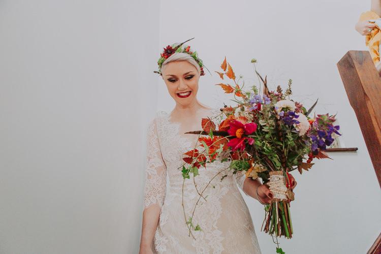 Bouquet Fowers Bride Bridal Feather Dahlias Wild Naturual Orange Red Autumn Weekend Extravaganza Tipi Wedding http://bloomweddings.co.uk/