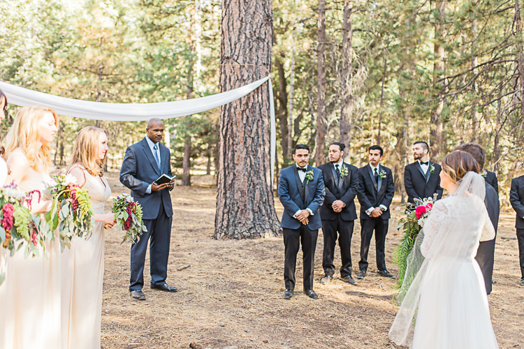 Outdoor Ceremony Bride Watters Separates Lace Top Tulle Skirt Veil Cascading Multicoloured Bouquet Father Groom Dark Blue Jacket Black Satin Lapel Black Pants Bowtie Groomsmen Black Suits Bridesmaids Ivory Dresses Celebrant DIY Whimsical Camp Wedding California http://www.landbphotography.org/