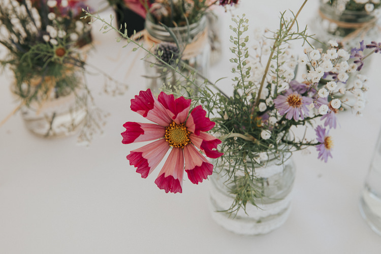 Jar Flowers Beautiful Flowery Country Marquee Wedding http://www.maddiefarrisphotography.co.uk/