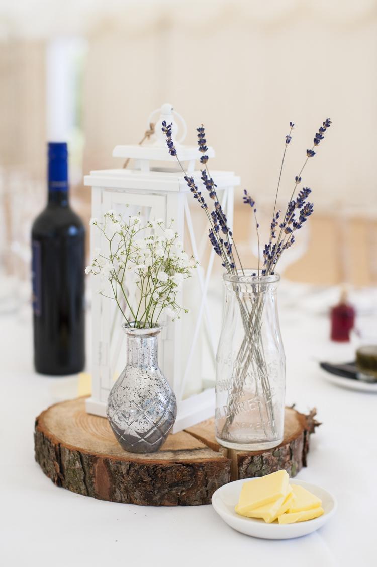 Centrepiece Log Lantern Candle Bottle Flowers Whimsical Summery Lilac Wedding http://eleanorjaneweddings.co.uk/