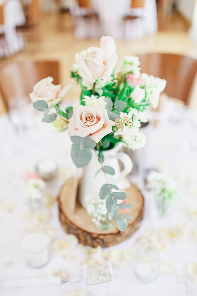 Centrepiece Log Jug Flowers Pink Cream Beautiful Rustic Fairy Lights Barn Wedding http://whitestagweddings.com/