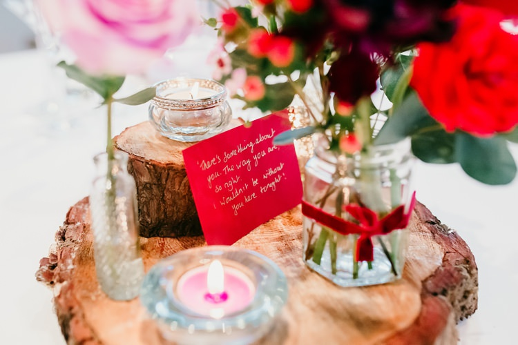 Table Centre Wood Slice Rose Jars Ribon Red Pink Candles Lyrics Fun Colourful Modern Music Wedding http://hollycollingsphotography.com/