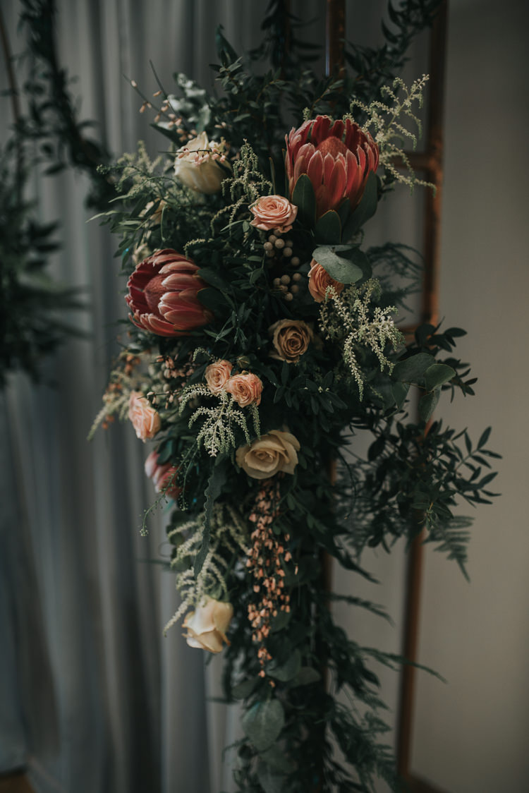 Flowers Pink Foliage Roses Protea Industrial Into The Wild Greenery Wedding Ideas http://www.ivoryfayre.com/