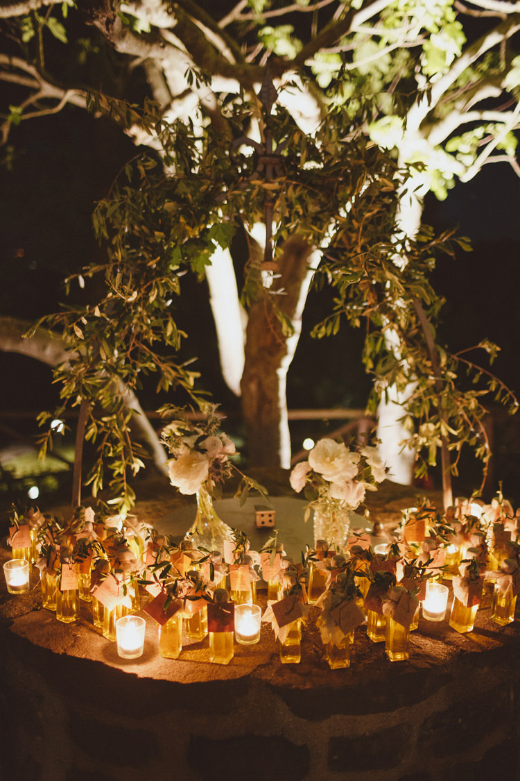 Candles Bottles Flowers Greenery Decor Beautifully Intimate Open Air Wedding Umbria http://www.edpeers.com/