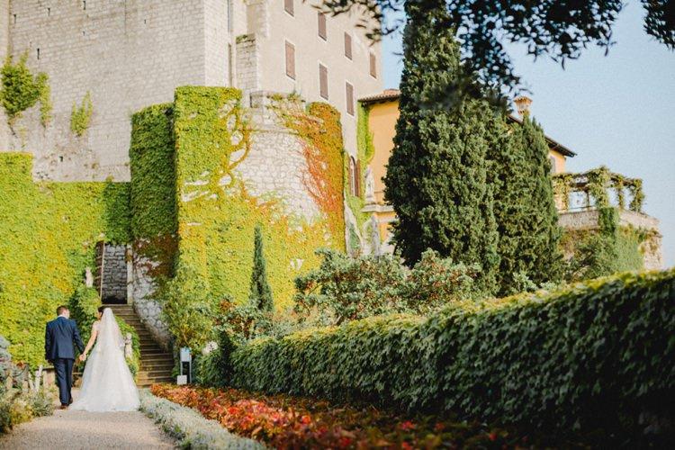 Castle Walls Holding Hands Romantic Vibrant Pink Wedding Trieste http://www.emotionttl.com/en/home/