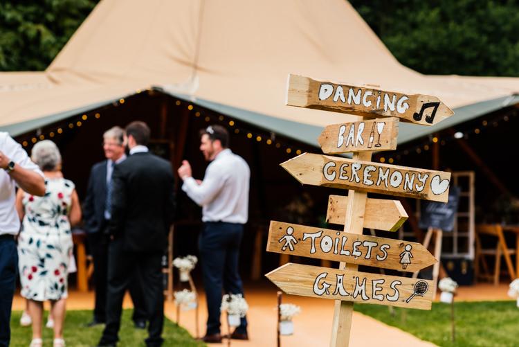 Wooden Rustic Painted Sign Post Fun Loving Secret Garden Tipi Wedding https://www.aaroncollettphotography.co.uk/