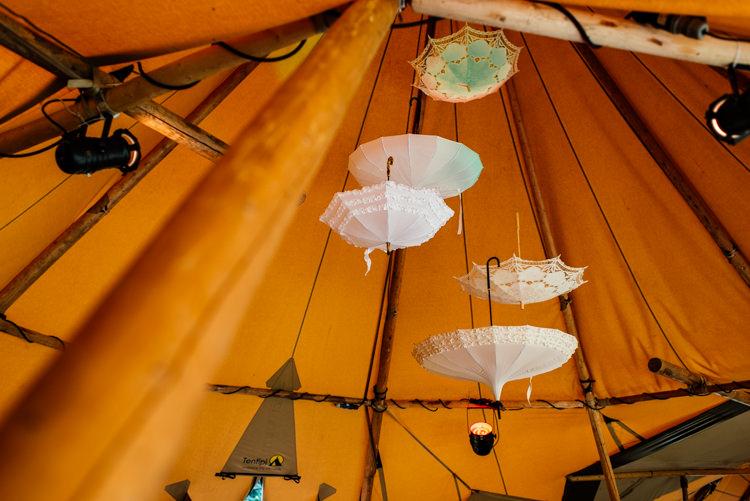 Hanging Umbrellas Decor Fun Loving Secret Garden Tipi Wedding https://www.aaroncollettphotography.co.uk/